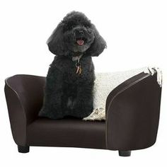 """Let your furry friend relax in style with this eye-catching pet bed, featuring a sofa-inspired silhouette and black upholstery and a storage pouch for toys.  Product: Pet bedConstruction Material: Wood and fabricColor: BrownDimensions: 16"""" H x 27"""" W x 16"""" D"""
