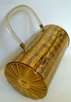Fab '50s gold and Lucite cylindrical purse by Majestic.