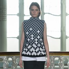 Pringle of Scotland has incorporated laser-sintered nylon fabric into garments in its Autumn Winter 2014 collection, shown at London Fashion Week.