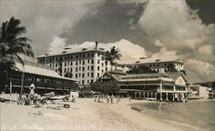 Moana Hotel Beach Front 1940s - The water comes all the way up to the oceanfront dining room at the Moana Hotel. The old dining room was demolished 1947. Real photo postcard taken from the Outrigger Canoe Club beach.