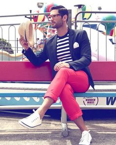 red pants, a striped tee, a black jacket and white Converse