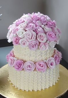 LOVE the flowers on top and around the second layer, and the pearls... not digging the squiggly stuff.