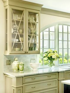 x motif glass front cabinets + arch over window