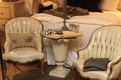 {The Willows Home & Garden: around the shop} tufted leather chairs