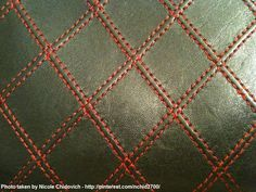 Close up...red quilted stitching on black leather. Christian Dior vintage wallet.