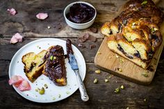 Chocolate brioche with chocolate and hazelnut spread and sugared rose petals