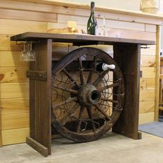 What a cute piece for a dining or entertainment room! We love the rustic feel of the wagon wheel with it's functionality as a wine rack! Found on westernfurniturestyle.com