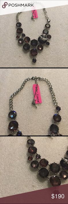 Betsey Johnson necklace Selling to buy betsey pieces I need. This is from the hematite collection. The charms include various sizes and shapes of stones, and a rhinestone sparrow. Super rare nwt Betsey Johnson Jewelry Necklaces