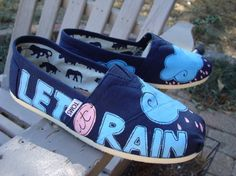 Let it rain painted on TOMS shoes.