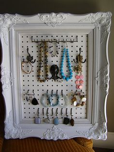 A great DIY way to organize jewelry using a frame and peg board.