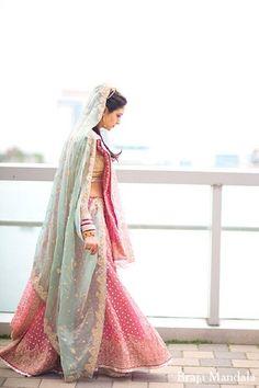 An Indian bride chooses soft pastels for her wedding ceremony. Pakistani Wedding Dresses, Pakistani Outfits, Indian Dresses, Indian Outfits, Wedding Lenghas, Saree Wedding, Desi Wedding, Wedding Attire, Wedding Ceremony