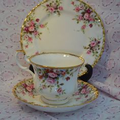 Vintage tea cup trio from royal Albert in the pattern Cottage Garden, comprising of tea cup, saucer, tea plate. This pattern was manufactured in the English factory from the 1960s to 1990. The pattern features bouquets of small roses in different shades of pink with sponged gilding around the edges of each of the pieces. The items in the trio are all in very good vintage condition free from chips, cracks, crazing, stains and the gilding is still bright and in good condition. As with all…