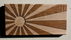 "This wall hanging is CNC routed in solid Walnut.    Dark grain color has received clear stain  Light color in grain and in routed areas is unfinished wood    6""x12""    Ready to hang      www.davemarcoullier.com"