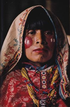 nationalgeographicscans: A painted prayer blooms on the cheeks of a Huichol  Sierra Madre Occidental, Mexico's