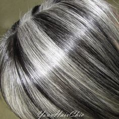 This is a Latina lady that has turned completely silver. I added black low-lights to give it some contrast and make her natural pop with brightness and have a chrome like shine. See more of my work on my facebook fan page   www.facebook.com/...