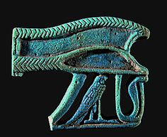 Ouadjet eye, the Sacred Eye of Horus; Uraeus snake and falcon (Horus). Faience fragment (about 600 BCE), Late Period, Egypt.  National Maritime Museum, Haifa, Israel