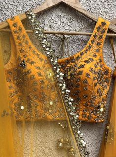 Gold sequins work blouse, with gold net lehenga with raw silk underlay teamed with net dupatta with butis and bugul work border. Choli Designs, Lehenga Designs, Saree Blouse Designs, Designer Bridal Lehenga, Bridal Lehenga Choli, Net Lehenga, Gold Lehenga, Yellow Lehenga, Stylish Blouse Design