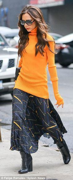 Orange you stylish! The 41-year-old swapped her usually all-black look for a bright marigo...