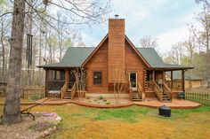 Back of Log Home Listed by Ginny Vickers