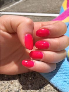 Shocking pink gel manicure on round nails