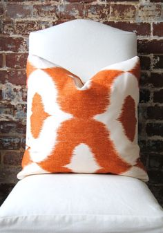 I want this pillow   Decorator Fabric  Ikat print in Orange  Dalesford by MarthaAndAsh, $47.00