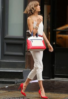 White jumpsuit and red stiletto's