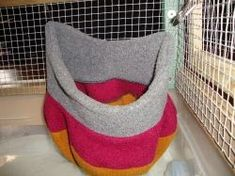 Simple and Easy Ways to Accessorize a Rat Cage -- use an old beanie as a hanging bed