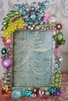 vintage jewelry on a picture frame