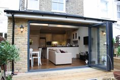 Take a look at our kitchen extension and side return gallery. View our variety o… Take a look at our kitchen extension and side return gallery. View our variety of Extensions in the capital. Request a Free Quote online. Small Kitchen Diner, Open Plan Kitchen Dining Living, Kitchen Diner Extension, Open Plan Living, Kitchen Ideas, Kitchen Extension With Conservatory, Kitchen Extension With Bifold Doors, Sofa In Kitchen, Kitchen Extension Side Return