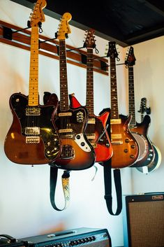 Electric guitars hanging on wall – Free Photo on Barn Images Hang Guitar On Wall, Guitar Wall Hanger, Guitar Room, Guitar Storage, Guitar Display, Recording Studio Home, Home Studio, Home Music Rooms, Rv Makeover