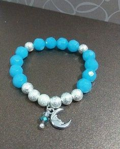Light blue glass faceted beads stretch bracelet with moon