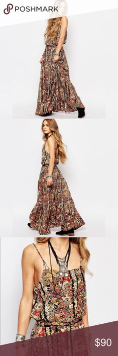 Free People Valerie Maxi Dress Floral printed maxi dress featuring an elasticized waist for an easy fit with an adjustable tie. Ruffle trim throughout and a low scoop back with crisscross straps. Fully lined. Size small. Only worn once. Free People Dresses Maxi