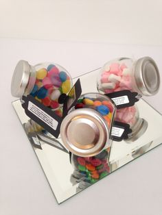 Mini Sweet Jar Favours - One of our most popular favours.  Mini Sweet Jars filled with tasty goodies.  Each jar has own tag so can also be used for place settings