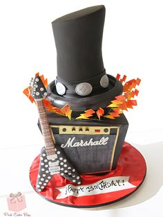 "Rock N' Roll Birthday Cake includes Slash's Hat, a Marshall Amp and the iconic Polka Dot Flying 'V"" guitar."