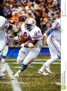 Earl Campbell stiff arms Nolan Cromwell  78704bf4a