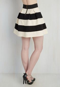 You can't help but feel like you hit the style lottery every time you decide to zip into this striped A-line skirt! The cotton-blend piece boasts a bold black and ivory pattern, which allows you to mix-and-match this skirt with a variety of tops. Whether a turquoise button-up blouse is tucked into the elasticized waist of this skirt or you combine the piece with a maroon cami and a classic sunflower-yellow cardigan, your ensemble is definitely going to be a hit with everyone you encounter!