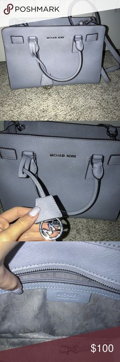Michael kors purse Michael kors purse in a light pastel grey! I'm super good condition and only used a couple times! No scratches or marks! KORS Michael Kors Bags Shoulder Bags