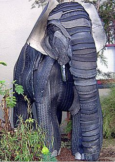 Elephant sculpture made from recycled tires. This is the first use of tire art that I have seen that is of this quality. Wow!