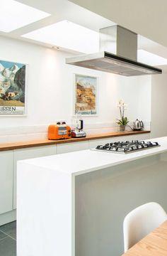 White kitchen with rooflights above. Yoakley Road by Bradley Van Der Straeten Architects.