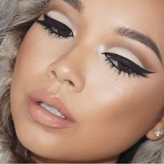 Taupe in the crease with light shadow and winged liner. Highlighter on the cheeks with a nude lip...very beautiful!!!:)