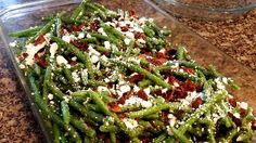 A versatile green bean side dish with crumbled bacon and feta cheese. Your guests will love it!