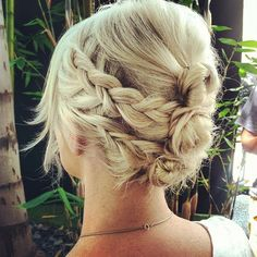 Two braids on each side with triple buns. Cute!