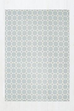 This printed low-profile rug is crafted from hard-wearing pure cotton. Furnished with a tiled circular print in steel grey, it's finished with stitched edges.THINGS TO KNOW:- 100% Cotton- Spot clean- Dimensions : 152cm (W) x 213cm (H)