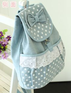PREORDER NOW! In stock soon!   Lovely korean backpack with bow decoration .Ideal as a gift to harajuku lovers. What's more? The lace detailing along with the polka dot pattern!   Zippered pocket on the back  Closure: Drawstring  Material: High quality Canvas Sizes: 30cm x 36cm  Care: Hand...