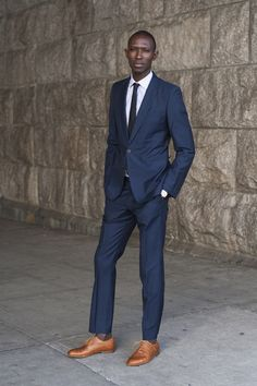 Shop this look for $249:  http://lookastic.com/men/looks/tie-and-dress-shirt-and-blazer-and-dress-pants-and-brogues/809  — Charcoal Tie  — White Dress Shirt  — Navy Blazer  — Navy Dress Pants  — Walnut Leather Brogues