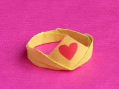 cute origami princess crown with a heart on the front