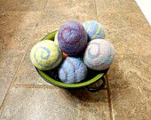 Ovella wool dryer balls. The Terra Swirl Collection Set of Nine (9) Naturally Dyed, colorful, earth tones, pink, purple, green, blue, yellow - pinned by pin4etsy.com