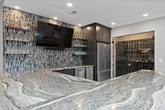 This homeowner got a custom whole home remodel to tie together their brand new basement and upstairs living space. This remodel includes a wet bar, game room, sauna, wine cellar, fireplace, and more!