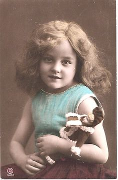 Old vintage photo - little girl with her doll.
