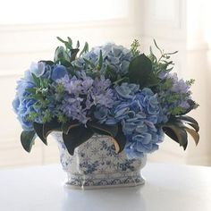 Our lush, handcrafted Hydrangea/Olive Leaf Floral Arrangement features beautiful blue blooms that are soothing and romantic.